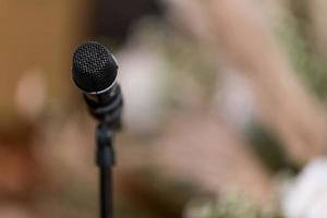 Microphone on stage, speaker, conference photo