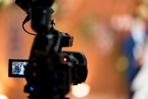 Videographer close up, cameraman, movie, man with camera, movie, professional camera photo