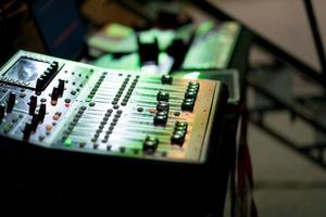 Sound check for concert, mixer control, music engineer, backstage photo