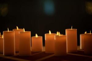 Candle in the dark, wedding candle with blur background photo