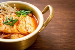 Kimchi Jjigae or Kimchi Soup with Soft Tofu or Korean Kimchi Stew photo