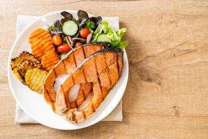Double grilled salmon steak fillet with vegetables photo