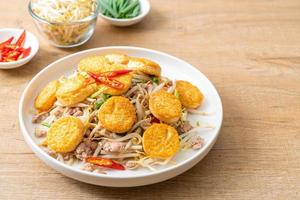 Stir-fried bean sprout, egg tofu, and minced pork - Asian food style photo
