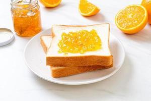 Slices of bread with orange jam photo