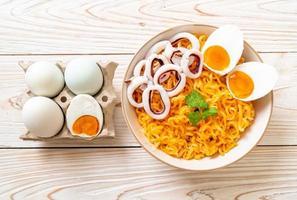 Instant noodles salt egg flavor with squid or octopus bowl photo