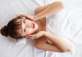 Young Asian woman at spa photo