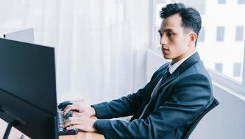 Asian businessman focused on working photo