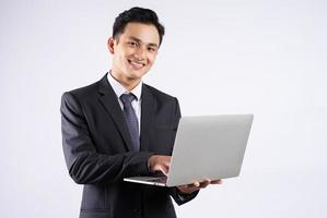 Asian businessman with laptop computer photo