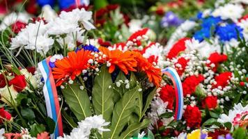 Flower bouquet with ribbon of Russia flag. National Day of the Russian Federation - image photo