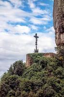 Barcelona Montserrat. Spain. Mountains, from afar visible place, mounted cross. photo