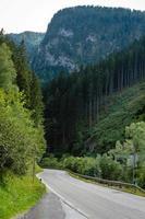 A picturesque asphalted mountain road through the Alps. Austria. photo