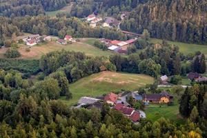 Vew from observation tower Pyramidenkogel to the mountain village,Carinthia,Austria photo