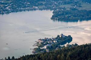 Evening view from observation tower Pyramidenkogel to mountains and lake Woerth,Carinthia,Austria photo