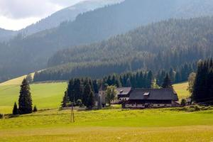 A typical small Austrian village at the foot of the Alpine mountains. photo