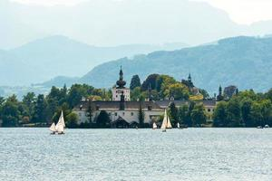 The castle of Schloss Ort in the Traunsee lake, Austria photo