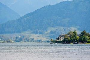 People relax at the Austrian mountain lake Worthersee. photo