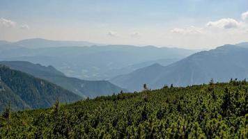 The Austrian Alpine mountain landscape on a hazy autumn day. photo