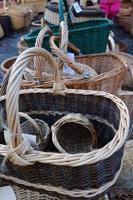 In the christmas  market a wide selection of a variety of hand-braided baskets. photo