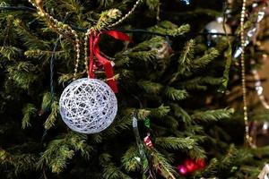 Various colorful Christmas decorations hanged spruce branches. photo