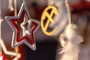 Different decoration, toy for xmas tree on christmas market, close up photo