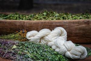 White yarn, dry flowers and grass photo