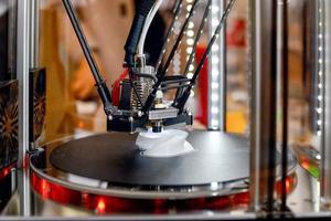 3D printer during work process photo