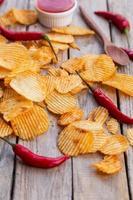 Homemade paprika potato chips and Chili sauce photo