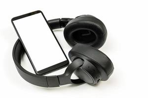 Headphones with Bluetooth technology on white background photo