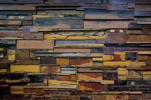 Old walls are made of different types of wood texture background photo