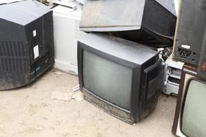 Assortment of dirty dumped objects photo