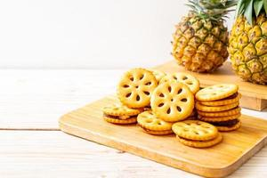 Biscuits with pineapple jam on wood background photo