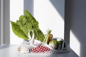 Vegetables arrangement in a textile bag photo