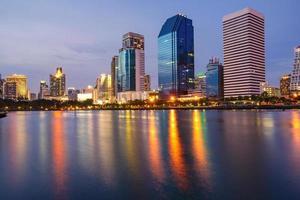 Bangkok city downtown at twilight with reflection of skyline, Benjakiti Park, Bangkok,Thailand photo