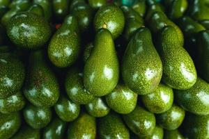 Avocados on a table at a street market photo