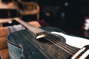 Wooden acoustic guitar On Hardwood Floor photo