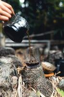 Drip coffee in the forest,pour hot water in coffee photo