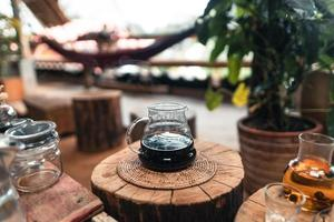 Pouring a hot water over a drip coffee photo