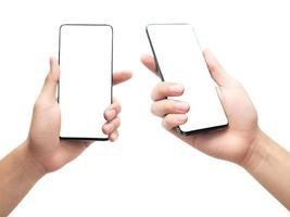 Hand holding smartphone on white background with clipping path photo