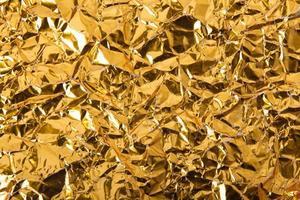 fondo de textura de papel arrugado dorado foto
