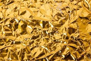 Gold paper crumpled texture background photo