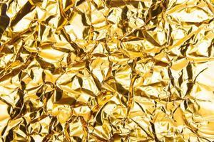 Golden cumpled paper texture background photo