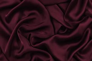 Abstract Satin Silky Cloth,Fabric Textile Drape with Crease Wavy Folds.with soft waves,waving in the wind.Texture of crumpled paper photo