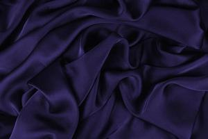 Background fabric. Dark textile fabric with texture and pattern drapery background photo