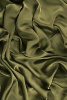 Smooth elegant silk or satin texture can use as abstract background. Luxurious background design photo
