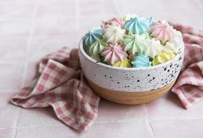 Small colorful meringues in the  ceramic bowl photo