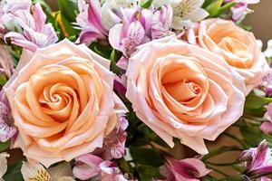 Background of a bouquet of pink roses. The concept of Valentine's day, birthday, International Women's Day. Design of holidays. photo