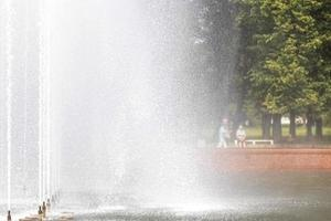 Background of the jets and splashes of the fountain in the park photo
