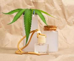 handmade natural cosmetic with cbd extract and green leaf photo