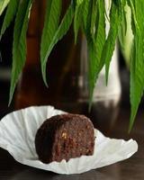 sweet cannabis chocolate brownie, recreational food with marijuana photo
