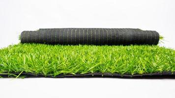 roll of artificial green grass isolated on white background, lawn photo